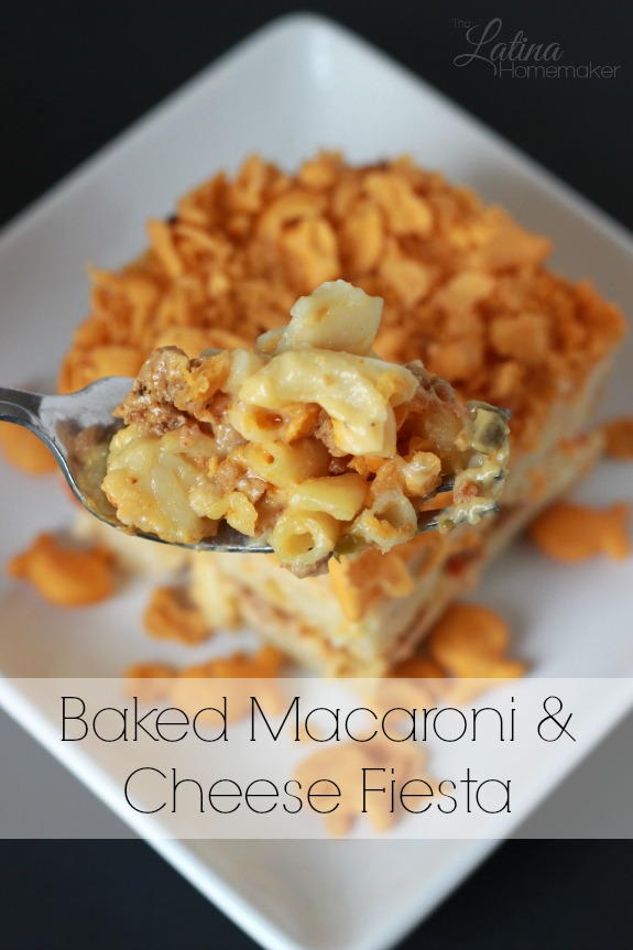 Baked Macaroni and Cheese Fiesta. A twist to the traditional baked macaroni and cheese recipe that includes ground meat and peppers with a cheesy crust.